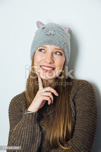 Attractive Long Haired Woman with Hat Feeling Thoughtful and Looking Away