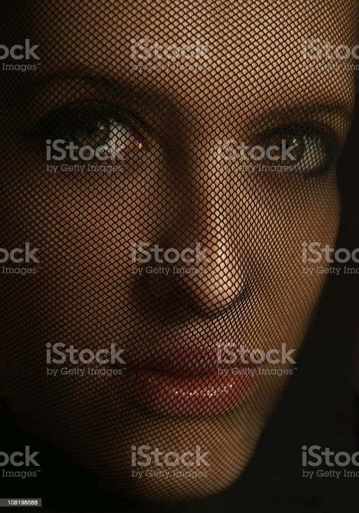 Portrait of Young Woman's Face Through Black Netting royalty-free stock photo