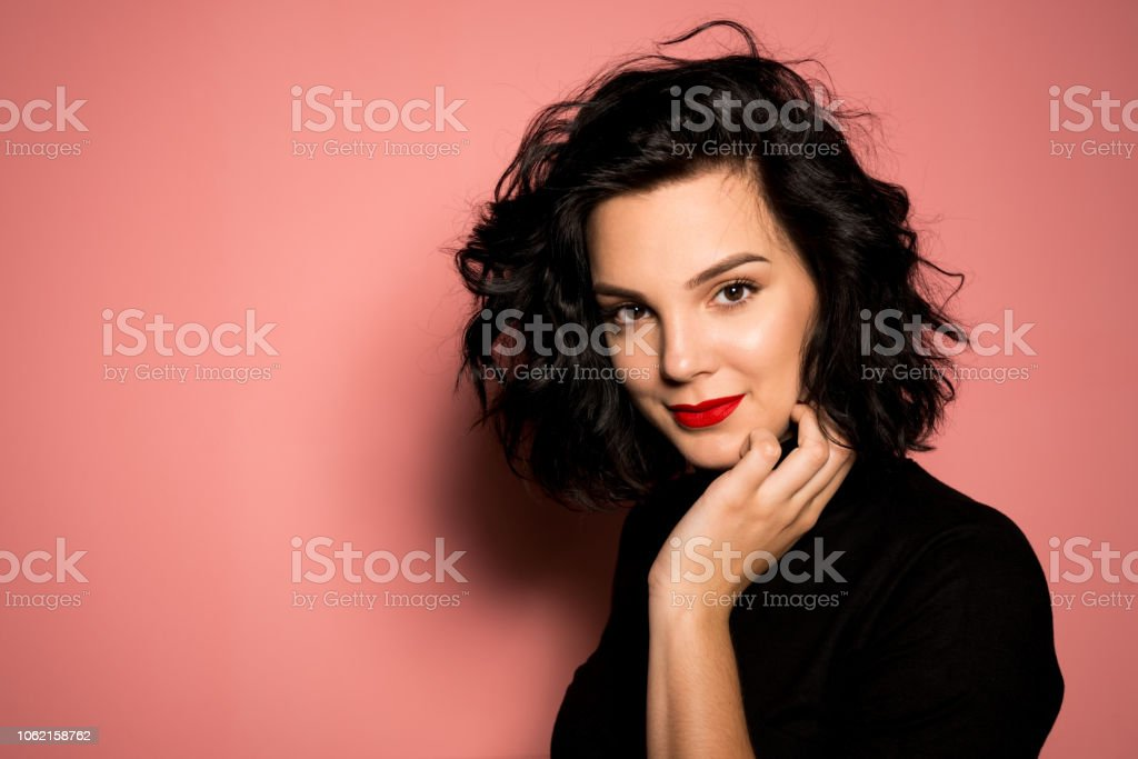 Portrait of young women on pink background stock photo