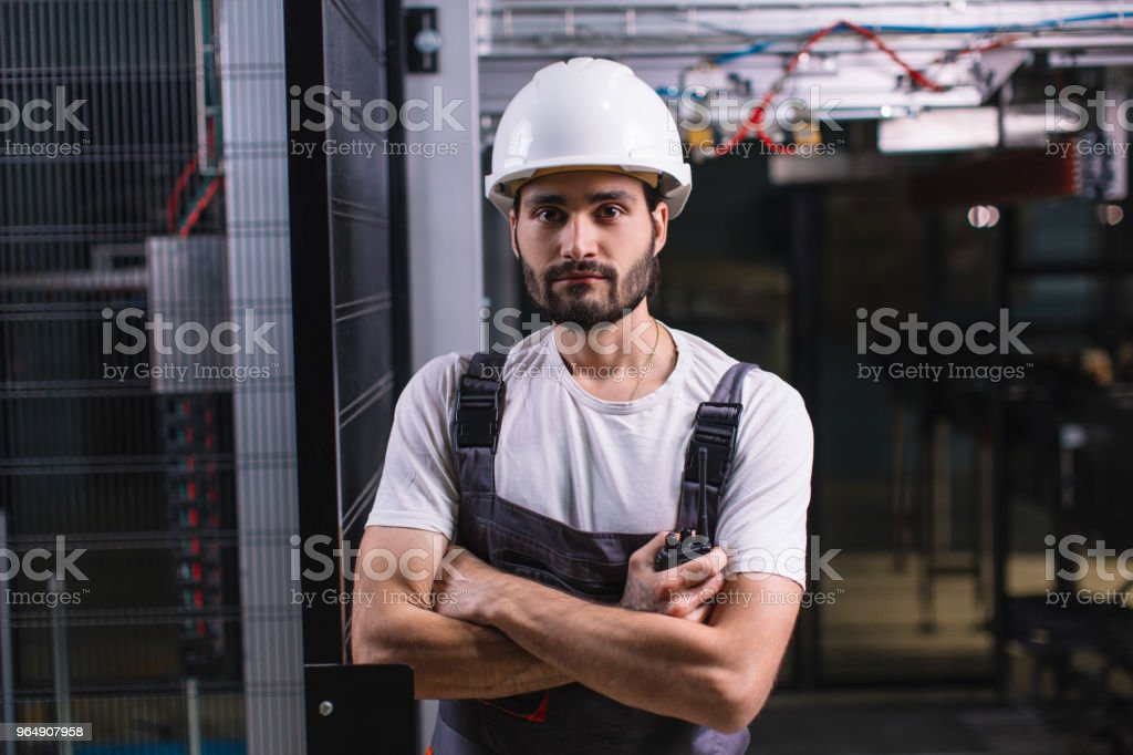Portrait of young workman on night shift royalty-free stock photo