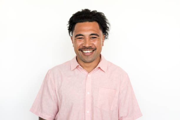 portrait on a white background of a new zealand maori man - maori stock photos and pictures