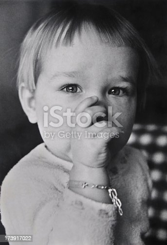 One year old boy, photographed in 1969. Black and White. Old photograph. Film grain to be seen.