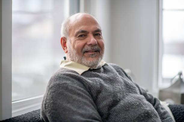 Portrait or senior man at home stock photo