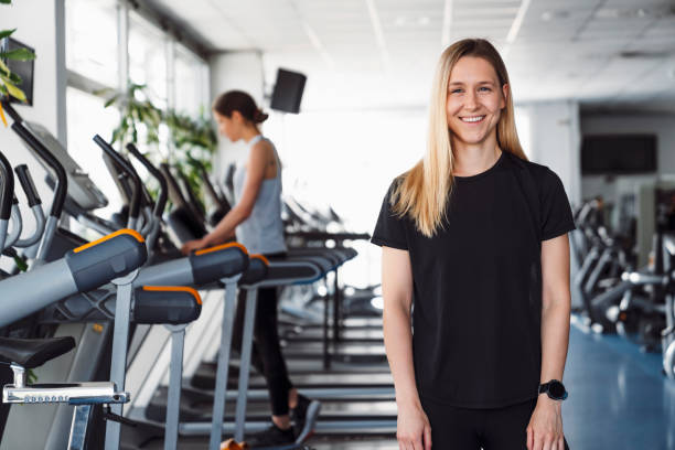 Portrait os a smiling female fitness trainer stock photo