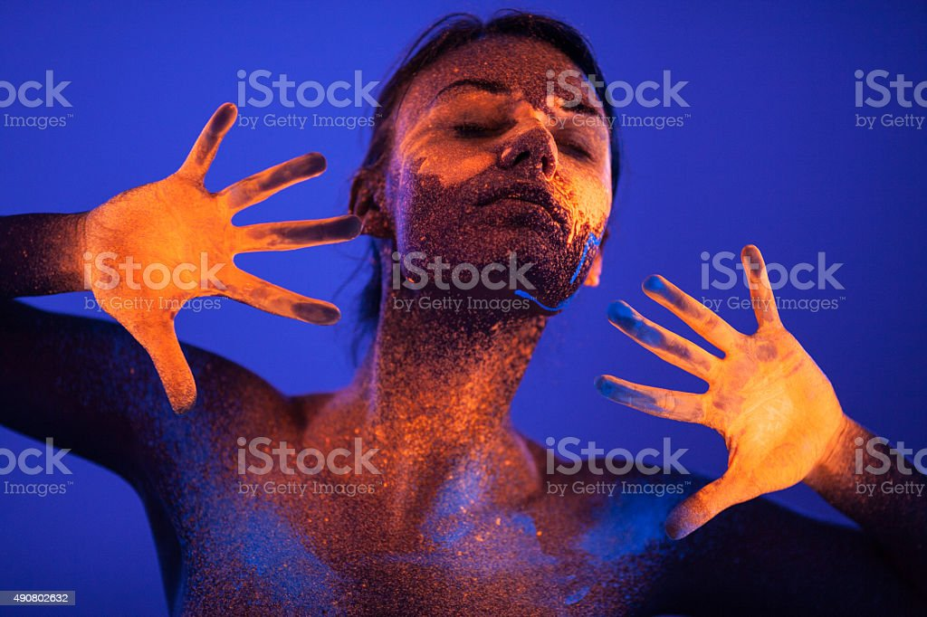 Portrait painted with fluorescent makeup under the ultraviolet l stock photo