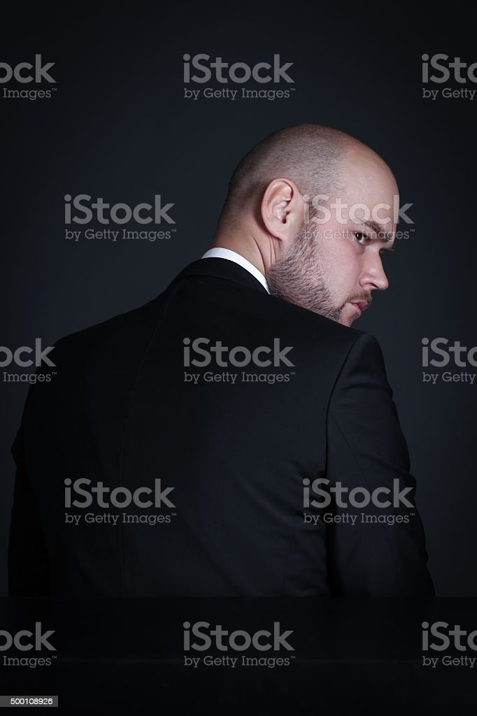 Portrait pensive stylish and brutal bald man with a beard stock photo