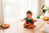 A child wearing a costume at home on Halloween day.