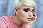 Portrait photo of young female model with short blond hair