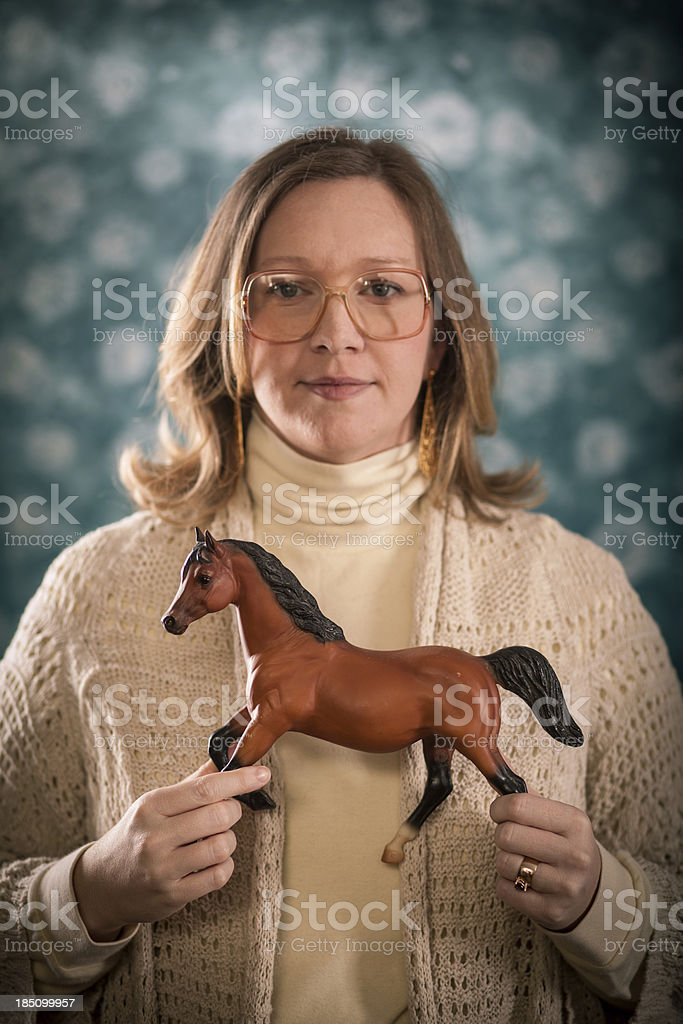 Portrait Photograph of Blond Woman Holding Toy Horses royalty-free stock photo