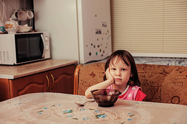 Portrait. The child is hungry. hungry child stock pictures, royalty-free photos & images
