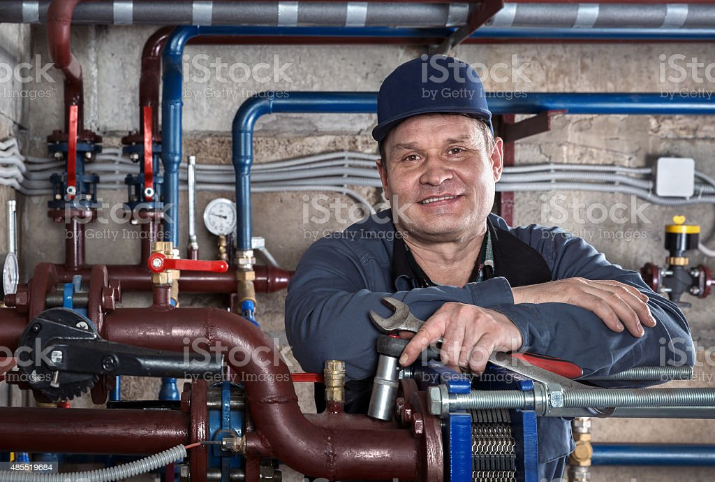 Portrait plumbing engineer. stock photo