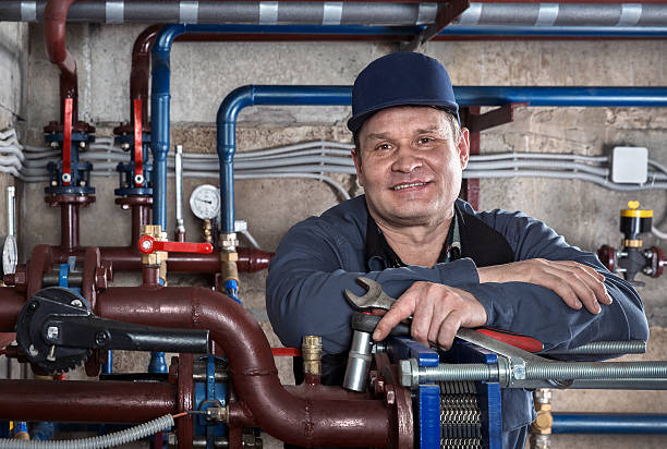 Portrait plumbing engineer. stock photo