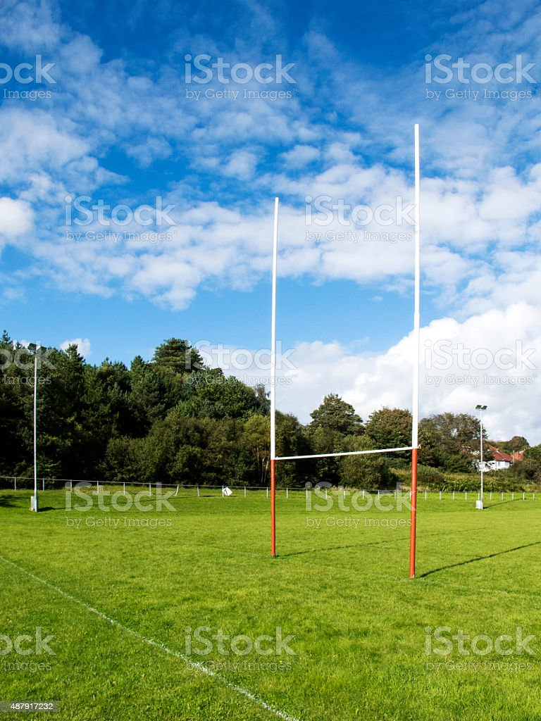Portrait rugby field with goalposts and summer sky stock photo