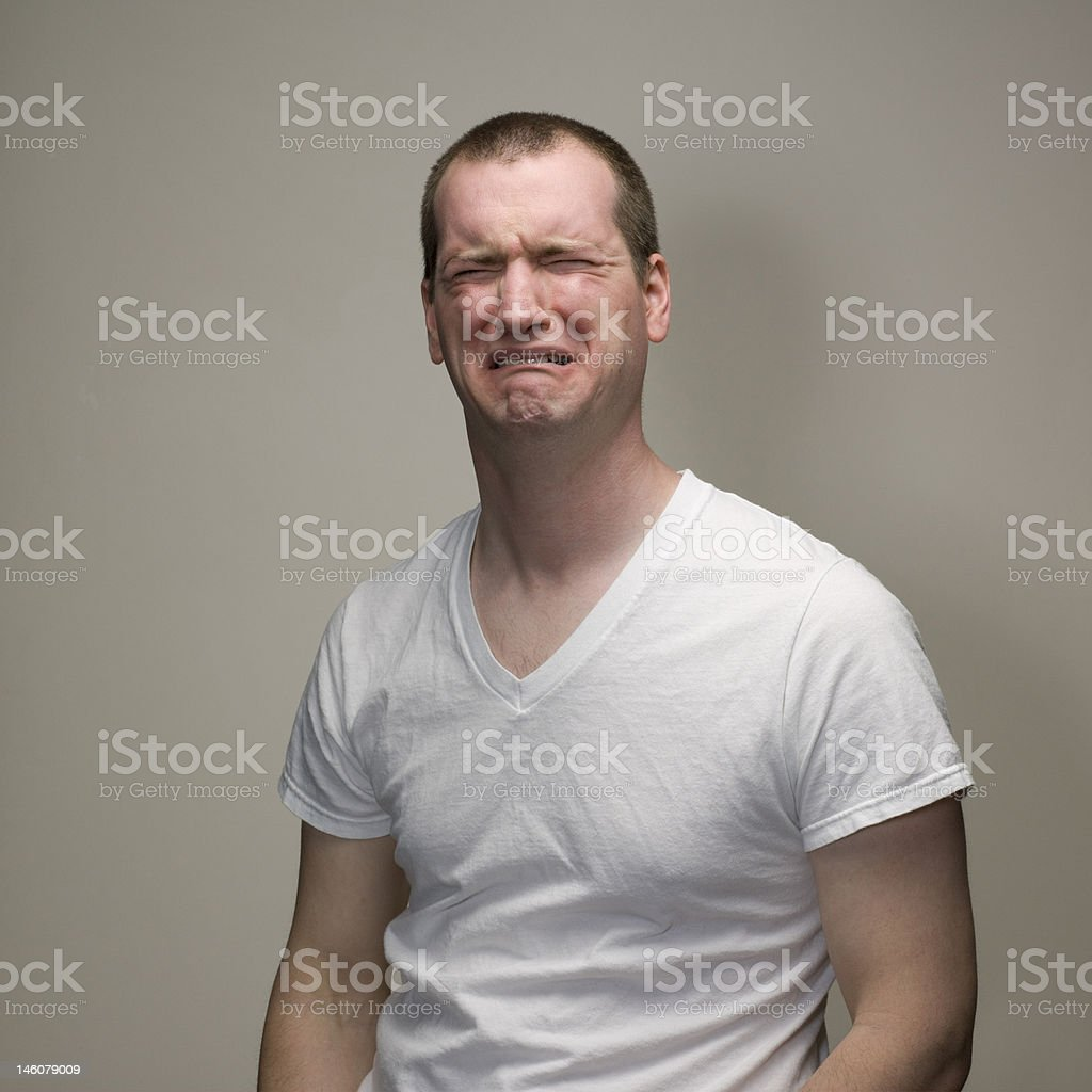Portrait of a man showing an emotion.