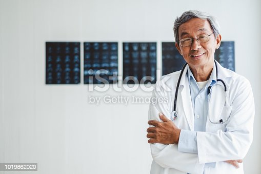 Portrait senior asian doctor over radiography background, asian medical concept