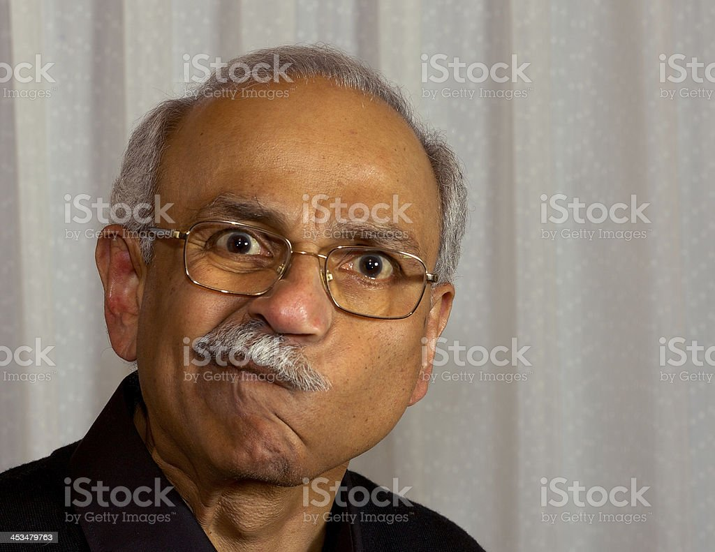 Portrait senior male - grey moustache and weird face royalty-free stock photo