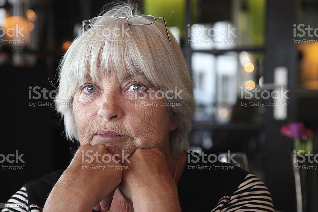 Portrait Senior Woman alone in a Restaurant royalty-free stock photo