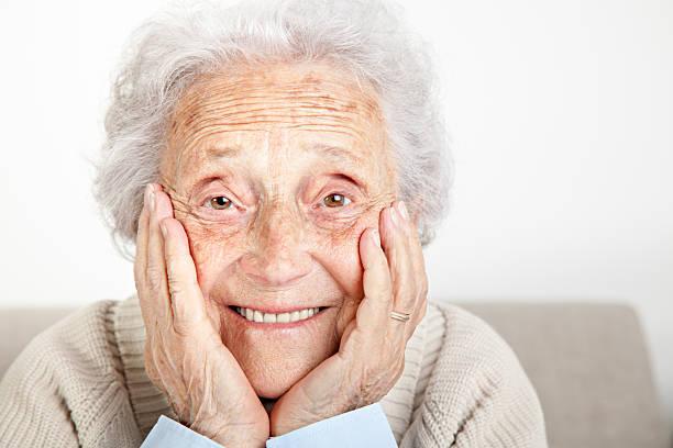 Portrait senior woman looking into camera stock photo