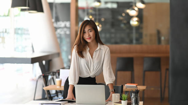 Portrait shot business woman in modern office workplace. stock photo