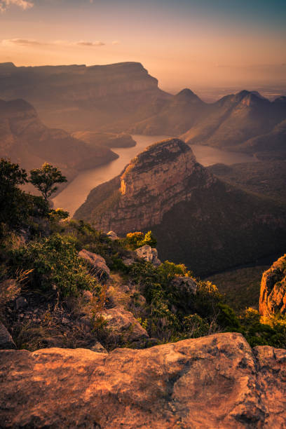 Portrait Shot of Blyde River Canyon bathed in dreamy warm pinks and oranges during pre-sunset golden hour. Mpumalanga, South Africa stock photo