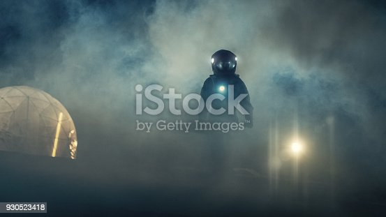 istock Portrait Shot of the Courageuos Astronaut  Wearing Helmet in Space, Looking around in Wonder. Space Travel, Exploration and Solar System Colonization Concept. 930523418