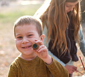 istock Portrait small boy with oak nut at the park 1127840447
