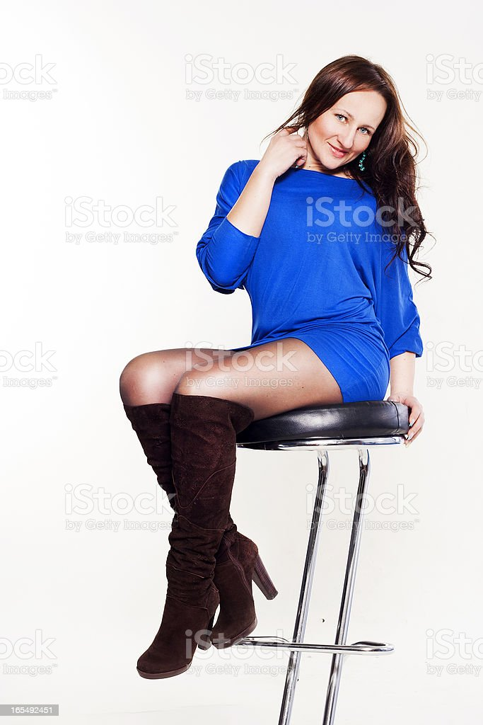 Portrait а smiley beautiful woman sitting on chair royalty-free stock photo
