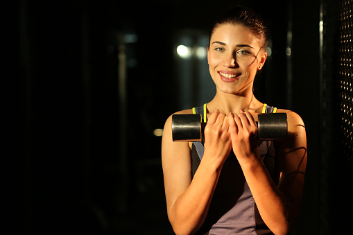 629605142 istock photo Portrait smiling fitness girl with dumbbells in gym 502814144