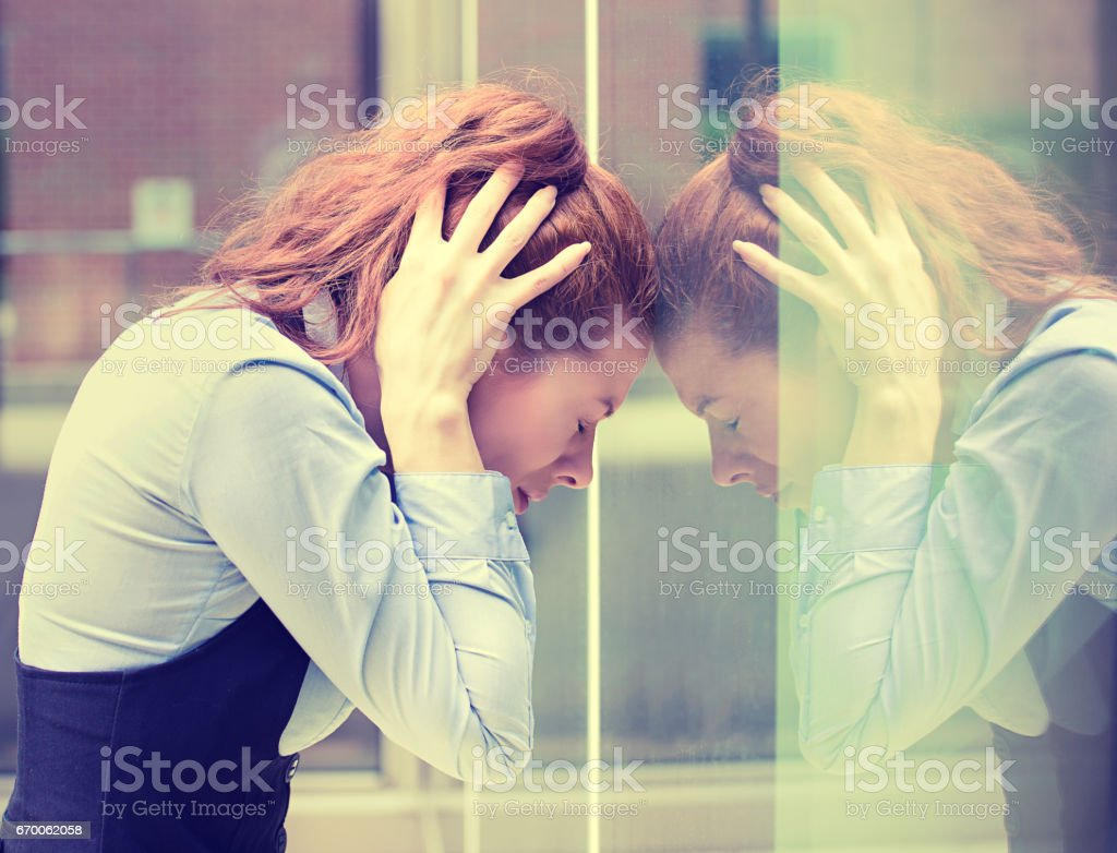 portrait stressed sad young woman outdoors. City urban life style stress stock photo