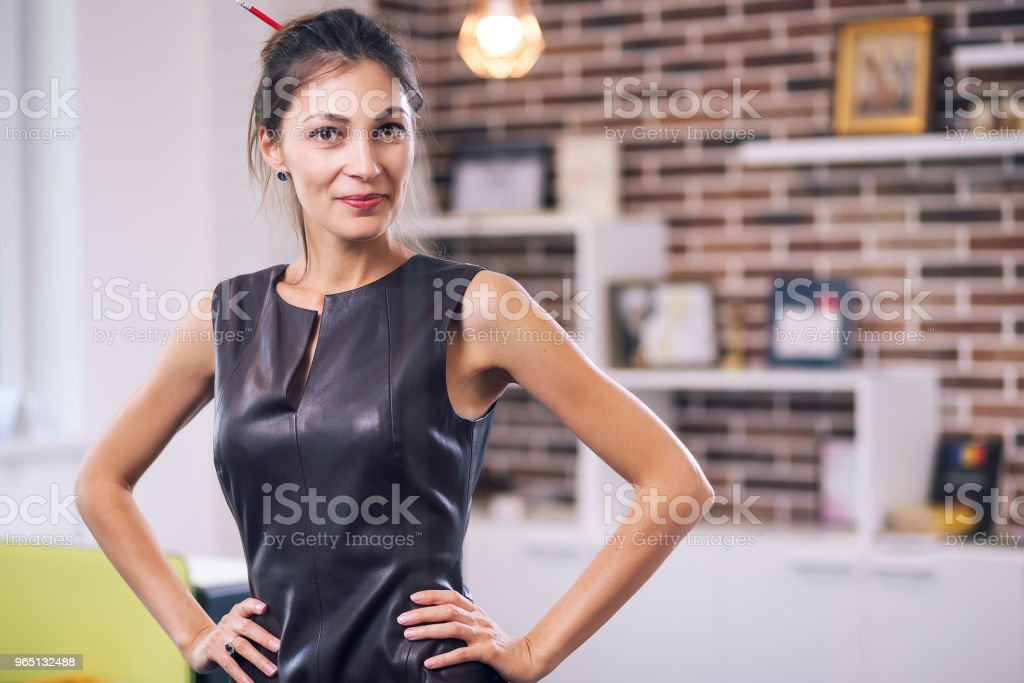 Portrait successful business woman with hands on waist zbiór zdjęć royalty-free