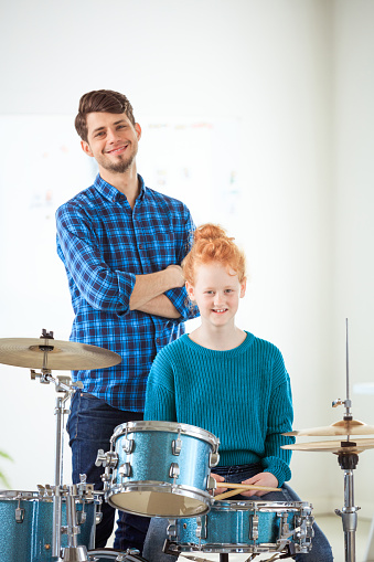 Portrait Teacher And Drummer In Classroom Stock Photo - Download Image Now