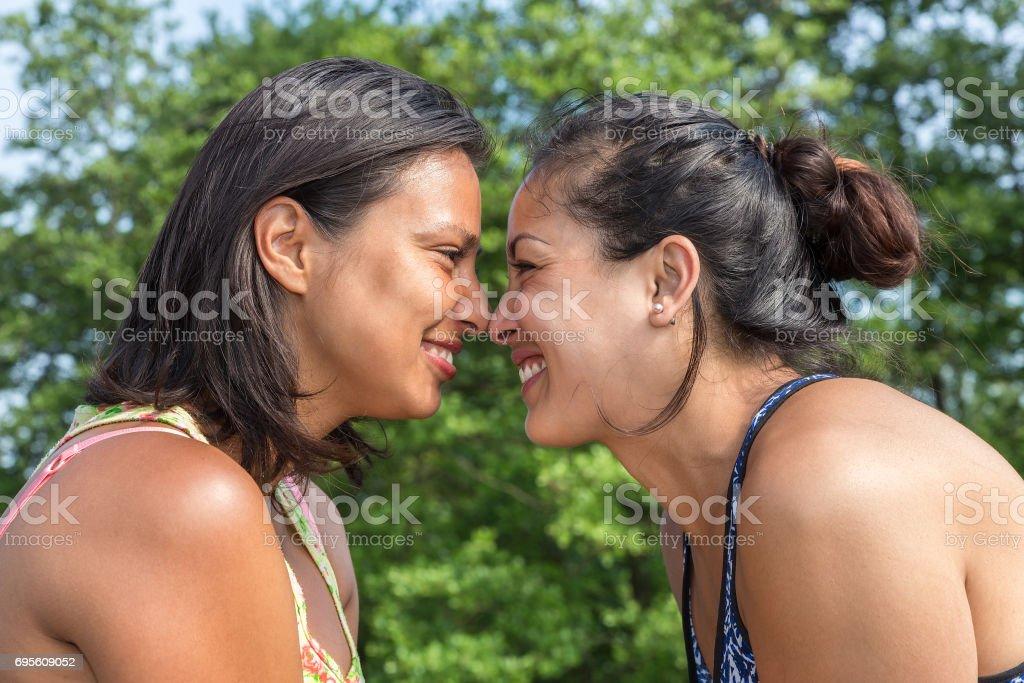 Portrait two women noses touching stock photo