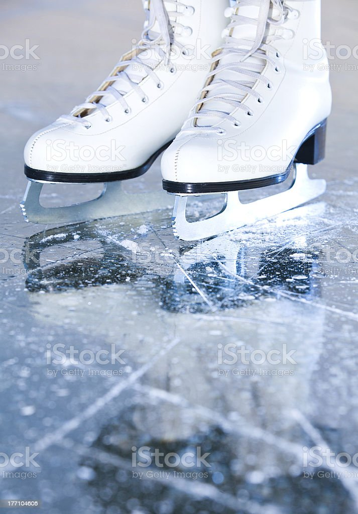 Portrait version, woman ice skates with reflection stock photo