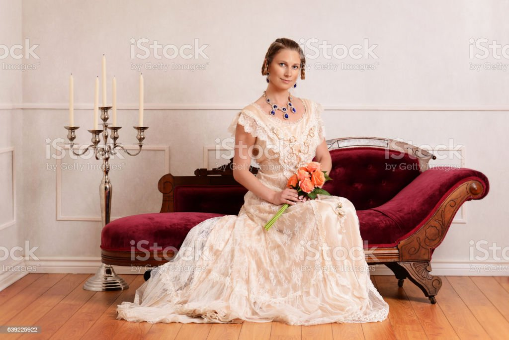 portrait victorian woman on couch stock photo