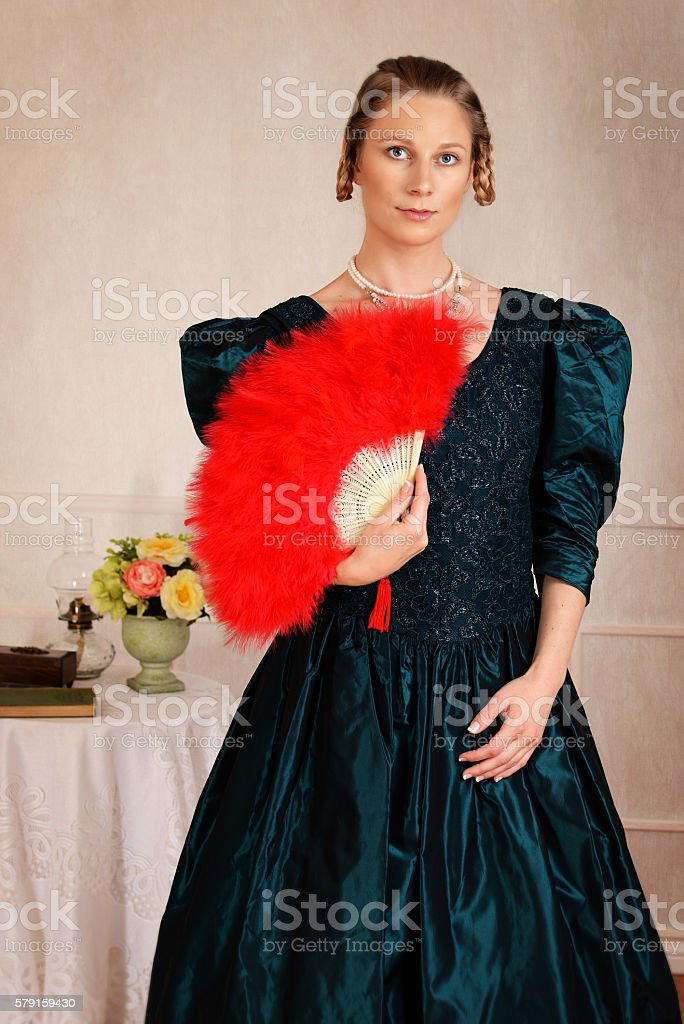 portrait victorian woman with red feather fan - Photo