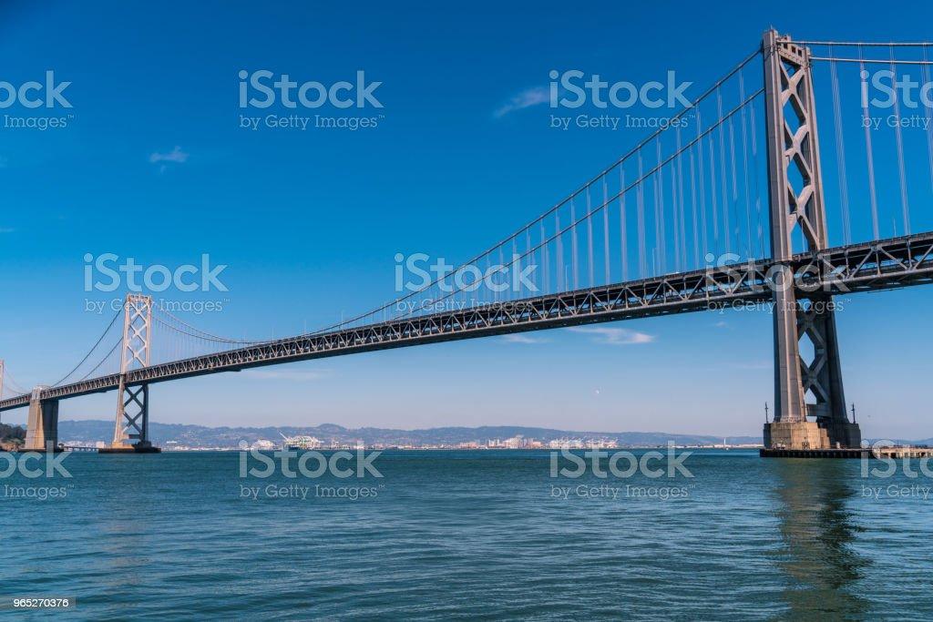 Portrait wide long distance Oakland Bay Bridge to San Francisco , California Suspension bridge over the Bay Area zbiór zdjęć royalty-free