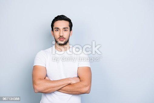 istock Portrait with copyspace empty place for advertisement of cute stunning strong sporty attractive manly guy holding arms crossed looking at camera isolated on grey background 967134388