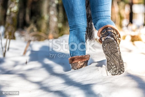 portrait woman boots on a road with snow in winter walking