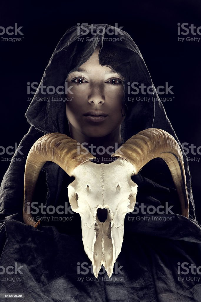 portrait woman in the hood with sheep's skull stock photo