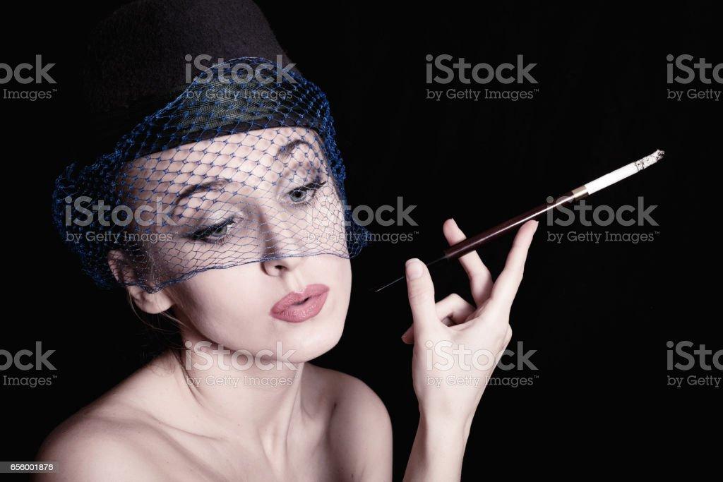 Portrait woman with cigarette in his hand. Retro style stock photo