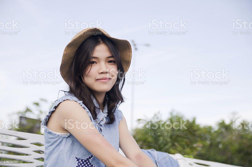Portrait women sitting outdoor on trees background stock photo