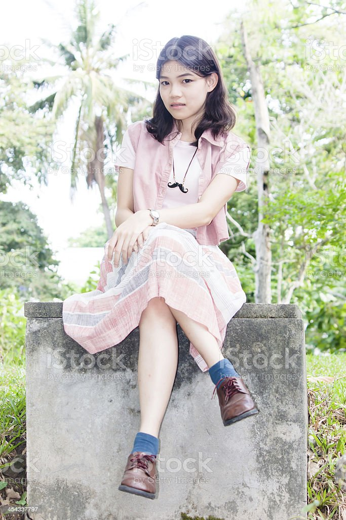 Portrait women sitting outdoor on trees backgroung stock photo