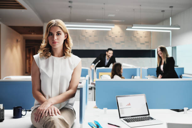 portrait worried business woman looking at camera in coworking office - disbarment stock pictures, royalty-free photos & images