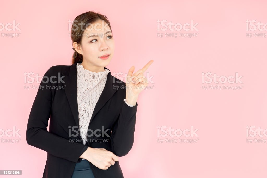 Portrait young Asian beautiful businesswoman, confident looking on pink background, thinking posing royalty-free stock photo