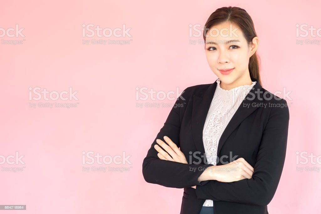 Portrait young Asian beautiful businesswoman, confident looking on pink background, arm crossed posing royalty-free stock photo