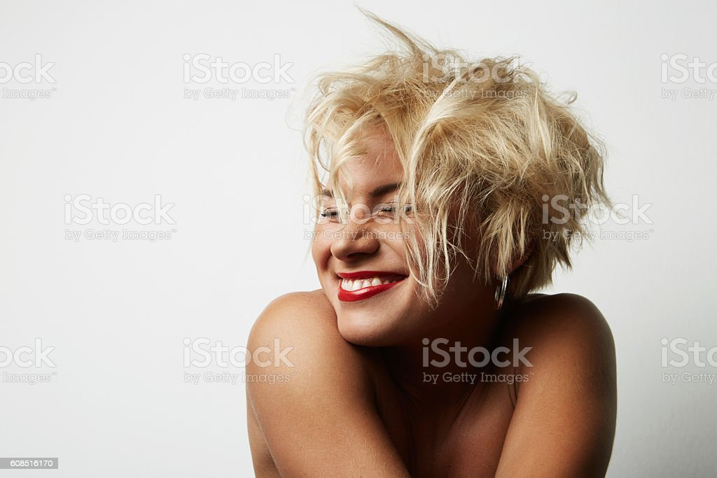 Portrait Young Blonde Head Female Perfect Skin Showing something Interesting стоковое фото