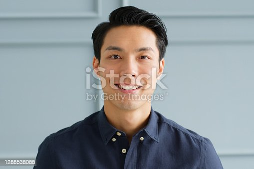 istock Portrait young confident smart Asian businessman look at camera and smile 1288538088