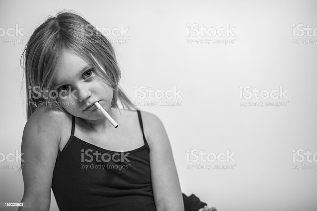Portrait, Young Girl with Cigarette in Mouth, Black and White stock photo