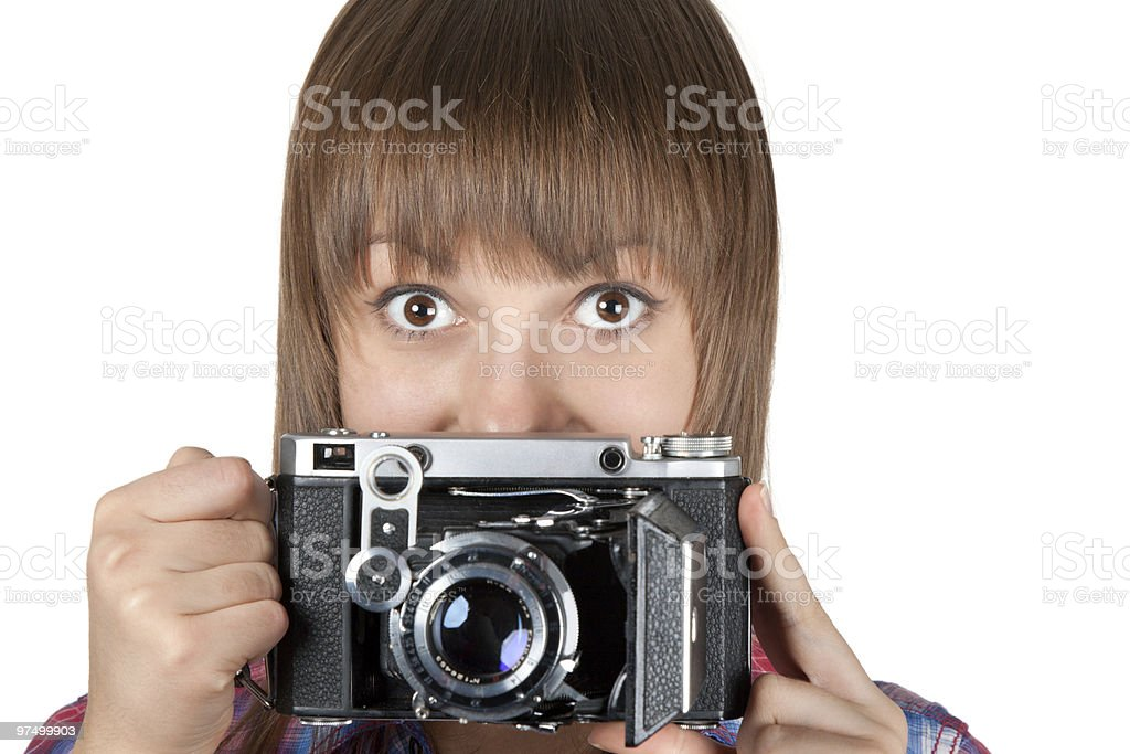 Portrait young girl with old analog photo by camera royalty-free stock photo