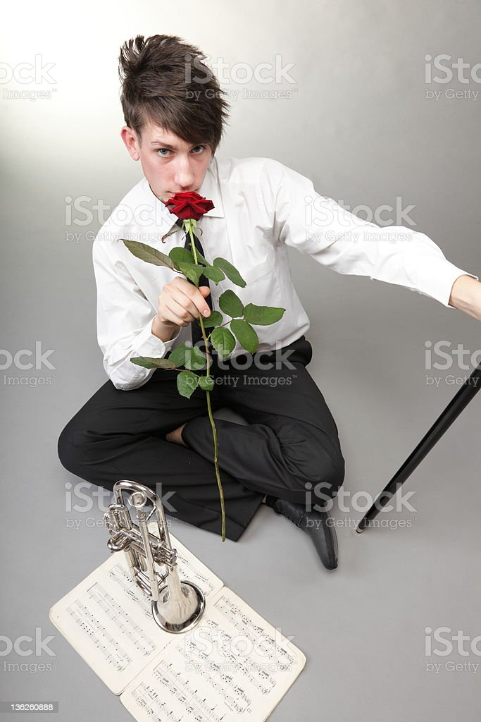 Portrait young man enamoured love Trumpet and red rose royalty-free stock photo